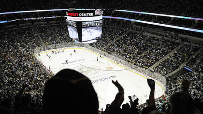 Fans cheer in the third period of Thursday&#039;s game at Consol Energy Center.