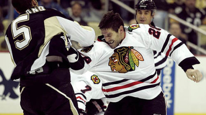Blackhawks forward Jake Dowell fights Penguins defenseman Deryk Engelland.