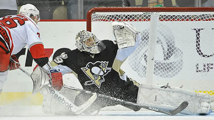Penguins goaltender Marc-Andre Fleury makes a save on Hurricanes forward Jussi Jokinen during the shootout of Friday's game at Consol Energy Center.