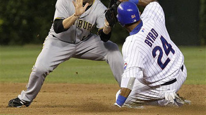 The Cubs' Marlon Byrd steals second base as Neil Walker is unable to field a throw from catcher Ryan Doumit Monday at Wrigley Field.