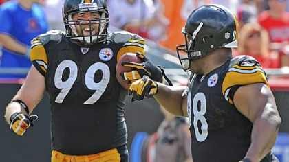 Defensive end Brett Keisel gets a congratulatory bump from Casey Hampton after Keisel returned an interception 79 yards for the Steelers&#039; final touchdown of the game.