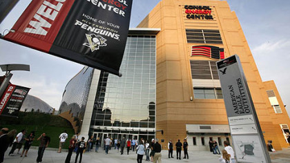 Hockey fans arrive at Consol Energy Center. It was the first hockey game to be played at the new building.