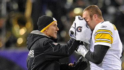 Steelers head trainer John Norwig stops the bleeding on Roethlisberger's broken nose during Sunday's game at M&T Bank Stadium in Baltimore.