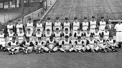 Row 1: Gene Baker, Roberto Clemente, batboy Bob Recker, Joe Christopher, Tom Cheney, Roy Face, Rocky Nelson, Bill Mazeroski, Bob Oldis. Row 2: Manager Danny Murtaugh, coach Frank Oceak, coach Sam Narron, coach Bill Burwell, coach Lenny Levy, Smoky Burgess, Dick Schofield, Gino Cimoli, Bob Skinner, Hal Smith, Bill Virdon, Don Hoak. Row 3: Traveling secretary Bob Rice, Harvey Haddix, Bob Friend, coach Mickey Vernon, Dick Groat, Joe Gibbon, Dick Stuart, Earl Francis, George Witt, Vernon Law, Fred Green, Wilmer Mizell, coach George Sisler, trainer Danny Whealan. The team photo was taken earlier in the season; not all those pictured were part of the World Series roster.